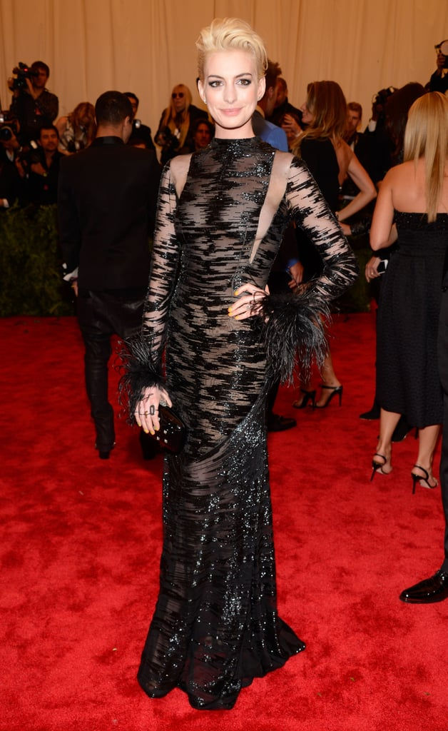 Anne Hathaway dyed her hair platinum blond to stay on the punk theme.