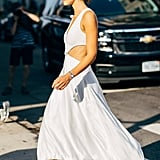 A slip cutout gown that could almost pass as bridal feels a little more relaxed with a low, walkable sandal.