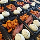 Boiled eggs with sides of savory turkey sausages and sweet potato bites