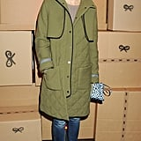 At Anya Hindmarch, Caroline Issa paired an olive green quilted coat with oversized statement earrings and a leopard print clutch.