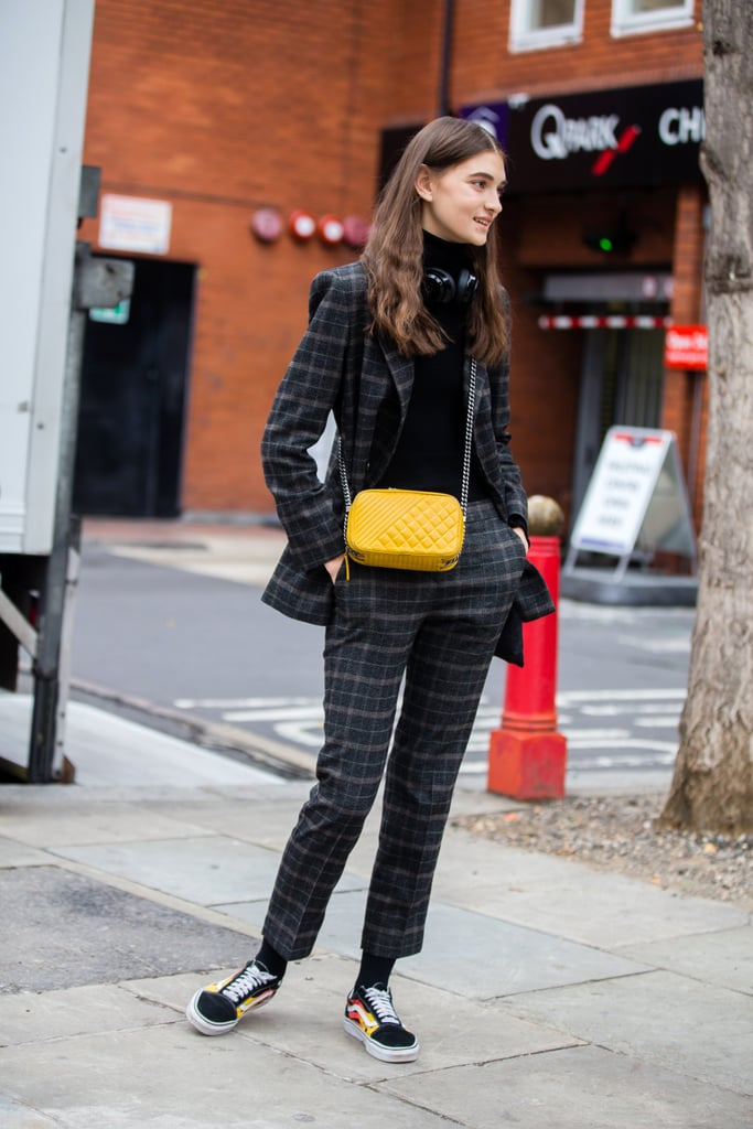 With a Plaid Suit, Turtleneck, and Bright Purse
