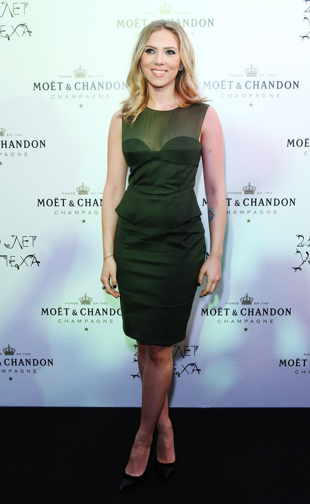 Scarlett Johansson posed at Moët & Chandon's anniversary party in Moscow in a sheer and peplum-trimmed Pucci.