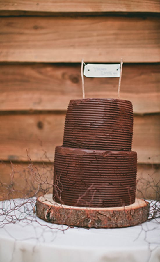 For the couple that loves chocolate, this two-layered, rustic-style cake is all about the bare minimum, and we mean that in a good way.  Photo by  Bayly & Moore via 100 Layer Cake