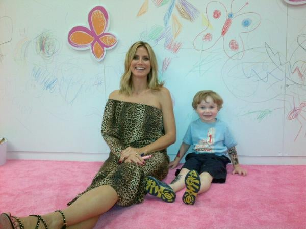"Heidi Klum sat with a pint-sized fan at the launch of her Babies ""R"" Us collection. Source: Twitter user heidiklum"