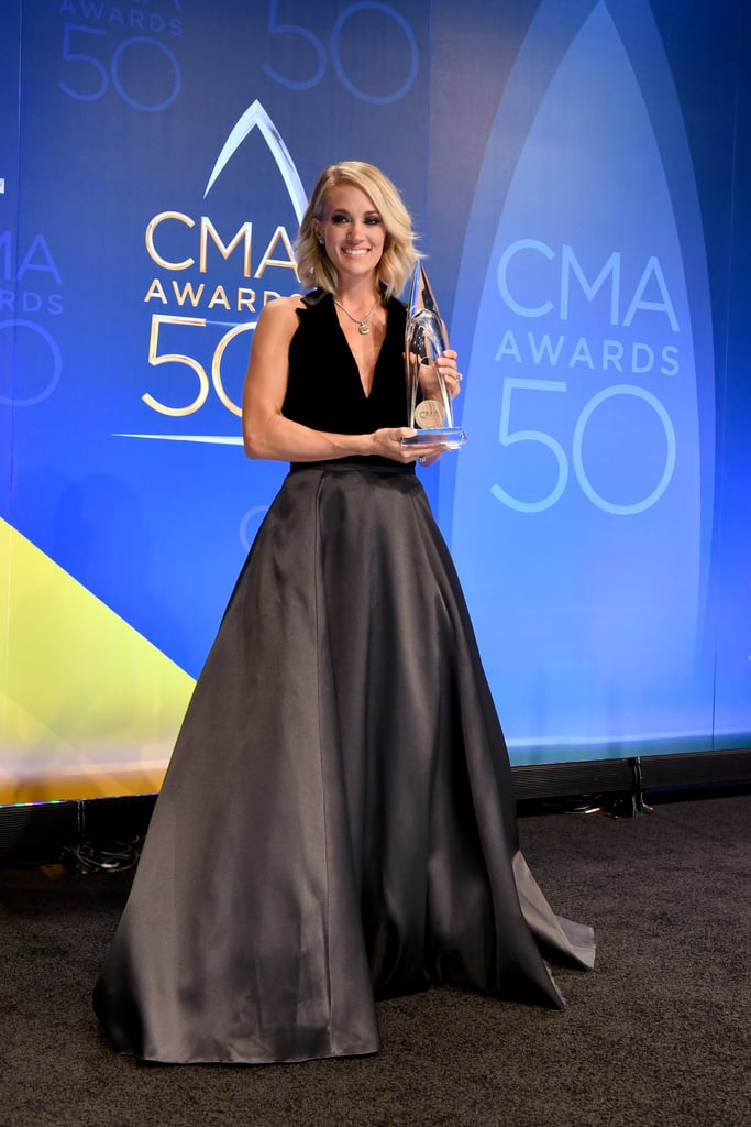 """Carrie Underwood made a dazzling appearance when she arrived at the CMA Awards in Nashville on Wednesday night. The """"Church Bells"""" singer looked stunning in a pink princess gown and was on hand to host the ceremony with Brad Paisley for the ninth consecutive time. It was an exciting night for the star, who is currently on her Storyteller tour. Not only did she rock 11 different looks and take the stage for an incredible performance of her hit song """"Dirty Laundry,"""" but she also took home the award for female vocalist of the year and joined her fellow country stars for a tear-inducing Dolly Parton tribute. It's safe to say that Carrie had an incredible night.       Related:                                                                                                           Carrie Underwood on Motherhood: """"I Feel Guilty That This Is My Son's Life"""""""