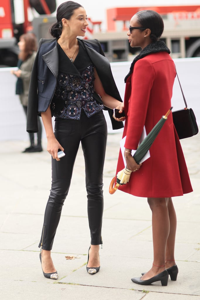 The meeting of fashionable friends — and fashionable looks; sequins and leather meet a classically-inclined ensemble.