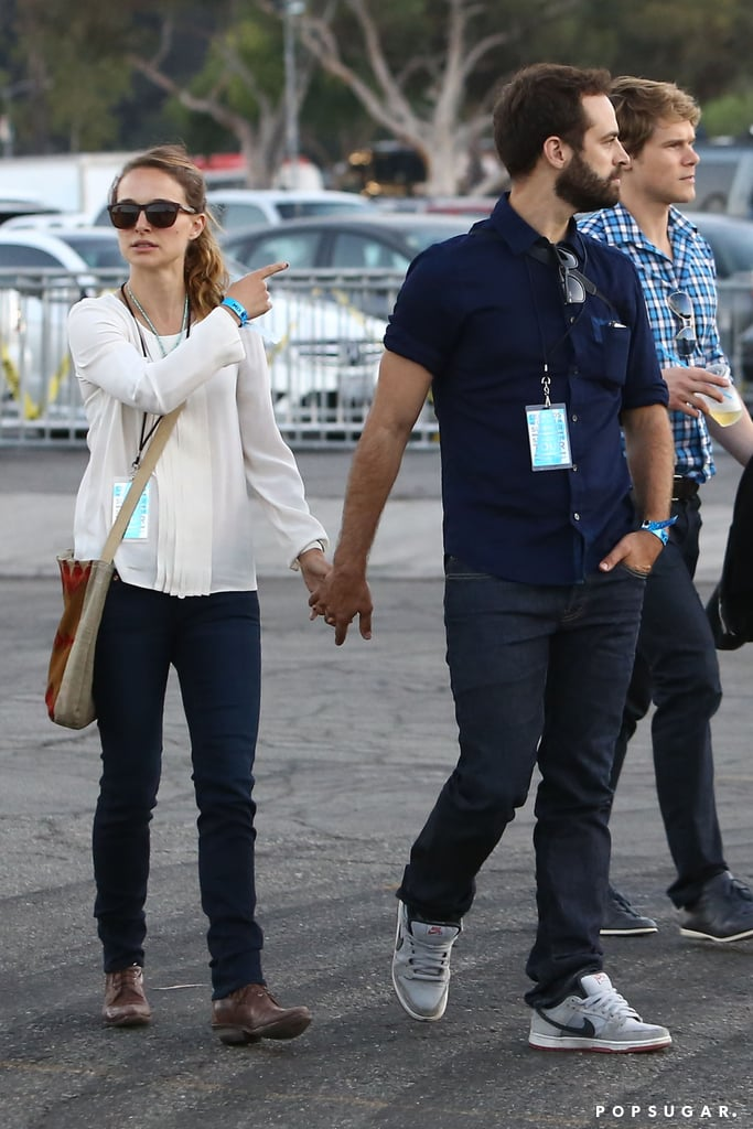 Natalie Portman and her husband, Benjamin Millepied, held hands on their way into the Rose Bowl to catch Jay Z and Justin Timberlake's Legends of the Summer stop in Pasadena.