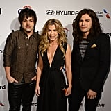 Neil, Kimberly, and Reid Perry of The Band Perry walked the red carpet at the 2015 Billboard Power 100 Celebration.