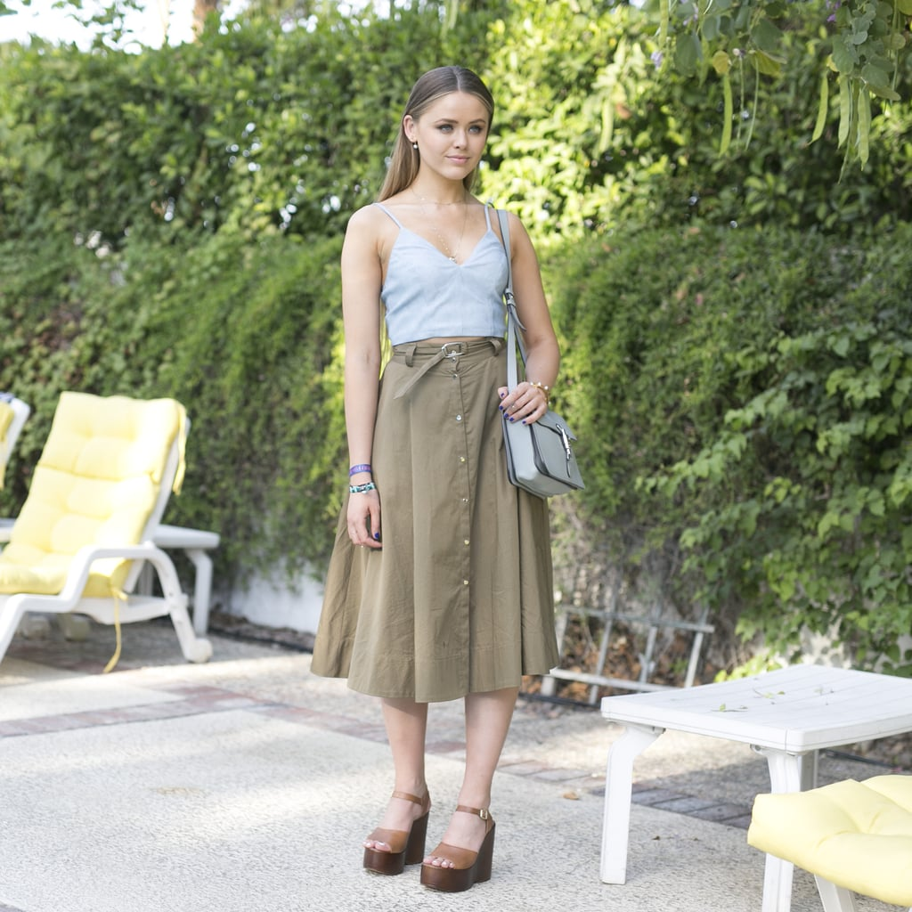 Neutral wedges elevated a look that was totally '70s: a powder blue strappy tank and a high-waisted button-front midi skirt.