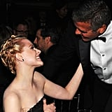 George Clooney popped by to say hello to Evan Rachel Wood.