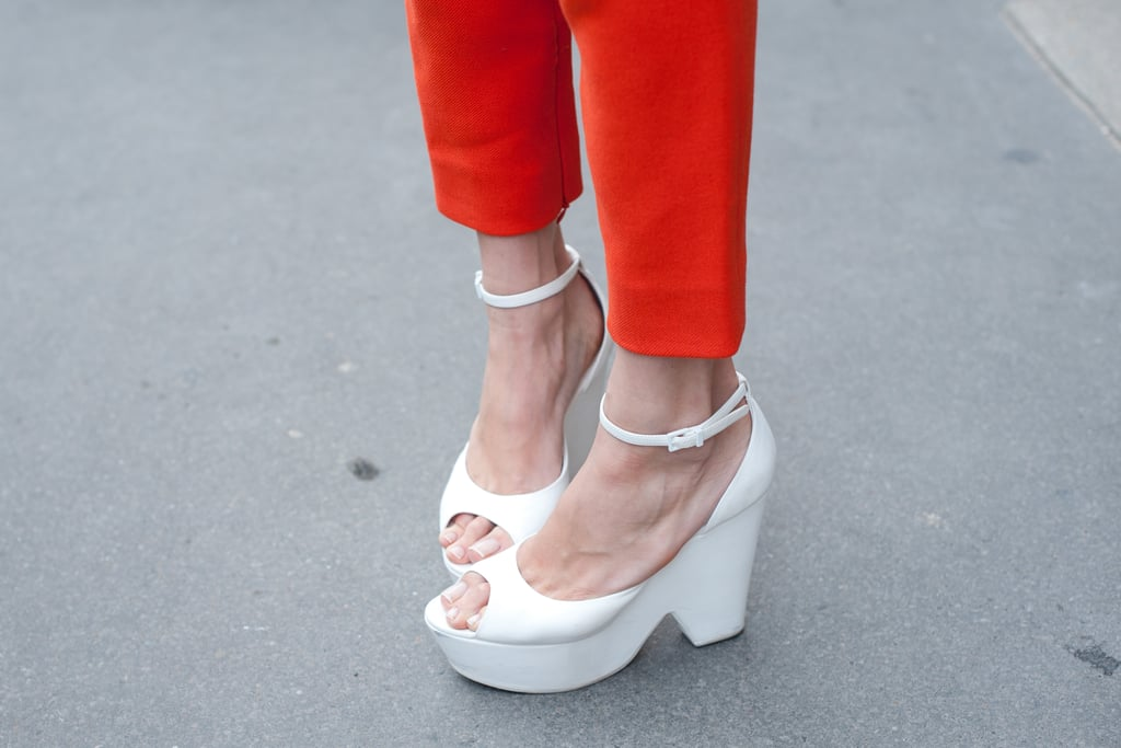 White platforms added serious statement power to a pair of ankle-crop orange pants.