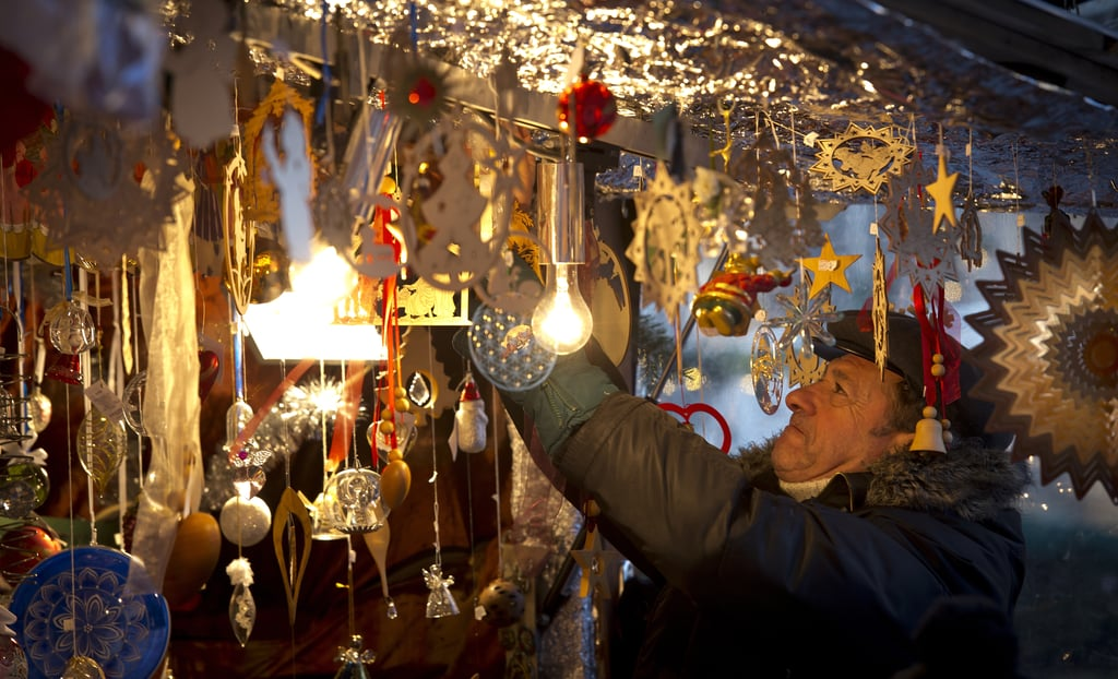 In Munich, Germany, Christmas market mongers hung lights with care.