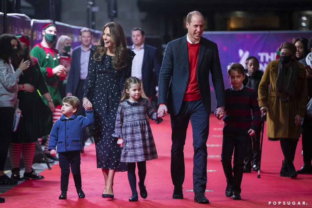 "It's a royal red carpet event! On Dec. 11, Kate Middleton and Prince William brought their children, Prince George, 7, Princess Charlotte, 5, and Prince Louis, 2, to a Christmas pantomime performance at the London Palladium. The family arrived in style, walking down the red carpet and waving with bright smiles. Most of them held hands, but Charlotte, being the independent royal she is, opted for a hands-free stride. While Kate modeled a long-sleeve dress with pumps, William sported a blazer with a red sweater and dress pants. The kids also wore snazzy attire as George and Louis donned sweaters with dress pants and Charlotte rocked a tartan frock with tights. The event marked the sibling trio's red carpet debut, adding to their list of 2020 ""firsts."" Their outing comes shortly after Kate and William wrapped their three-day mini-tour aboard the Royal Train. During the 1,250-mile journey, the duo visited different sites in England, Scotland, and Wales to thank essential workers and communities who have continued to work during the COVID-19 pandemic. Now, they get to wind down and enjoy some holiday entertainment with the kiddos. Look ahead to see clips and photos of the Cambridge family at the gathering!      Related:                                                                                                           Prince William and Kate Middleton's Family Is Just as Sweet as Their Royal Romance"
