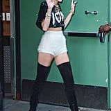 Miley Cyrus complemented the cropped proportions of her short shorts and top with a pair of boots that gave her legs for days!