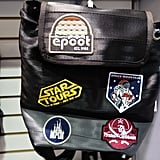 This incredible Harvey's seat belt backpack — a D23 Expo exclusive — was affixed with retro Epcot patches and nods to famed Disneyland attractions.