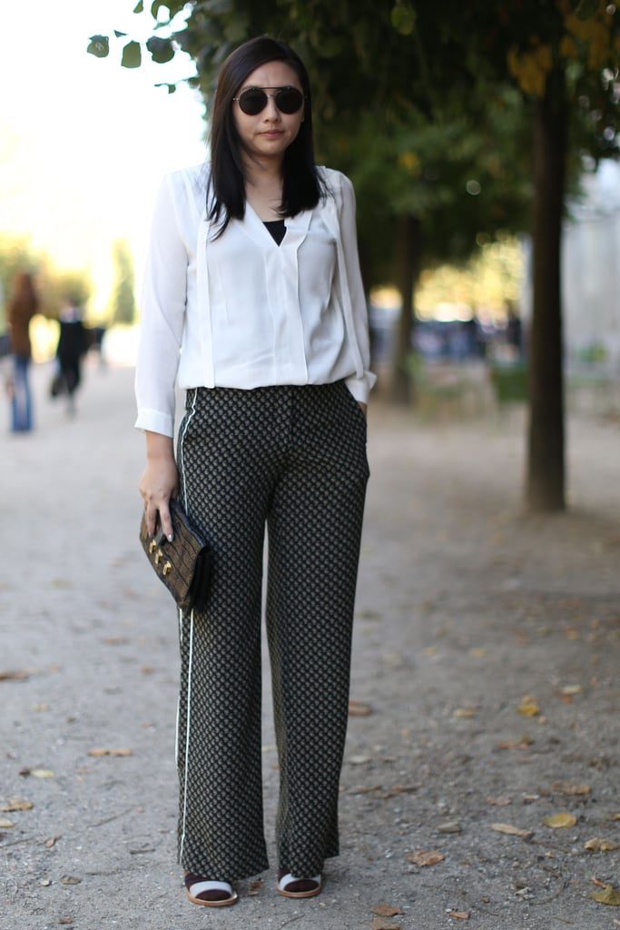 Just a pair of printed trousers upgrade a silky white button-down.