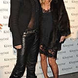Kate Moss and stylist Luigi Murenu posed on the carpet before entering the Kérastase's Couture Styling Line launch party on Monday in London.