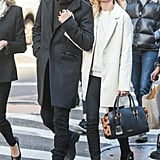 She debuted that same leather sweatshirt with a matching cream-coloured coat and a pair of black biker booties, all by Topshop, later on in the month when shopping in New York City.