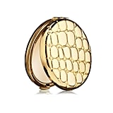 Men may no longer wear pocket watches with quite as much frequency, but this Estée Lauder Slim Alligator Compact ($40) is the modern equivalent for a young woman entering the workforce.