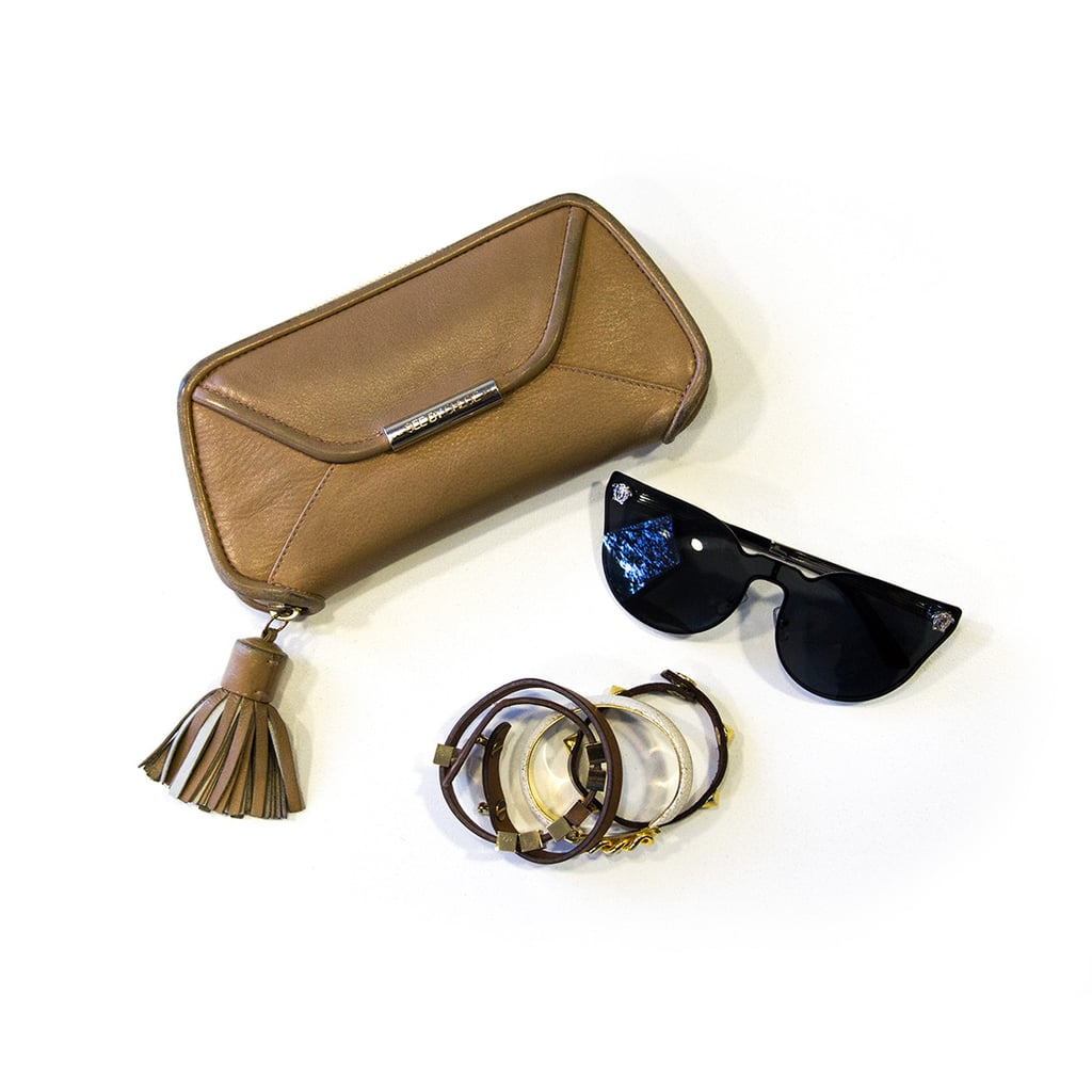 These come with me wherever I go: A wallet that can work as a clutch for evening, statement sunnies (current favourites are these catseye Versace shades), and a collection of wrist bling if I need to jzush for an after-work function.