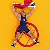 Polish wrestler Damian Janikowski celebrated from the ground after winning a bronze medal.
