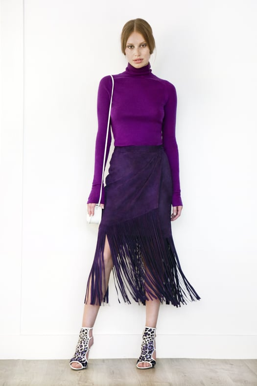 Turtleneck Cashmere Sweater, Suede Fringe Skirt in Purple, Trouble Maker Pony Open Toe Sandal Bootie in Grey Leopard, Treasure Watersnake Small Cross Body Bag in Cream. Photo courtesy of Tamara Mellon