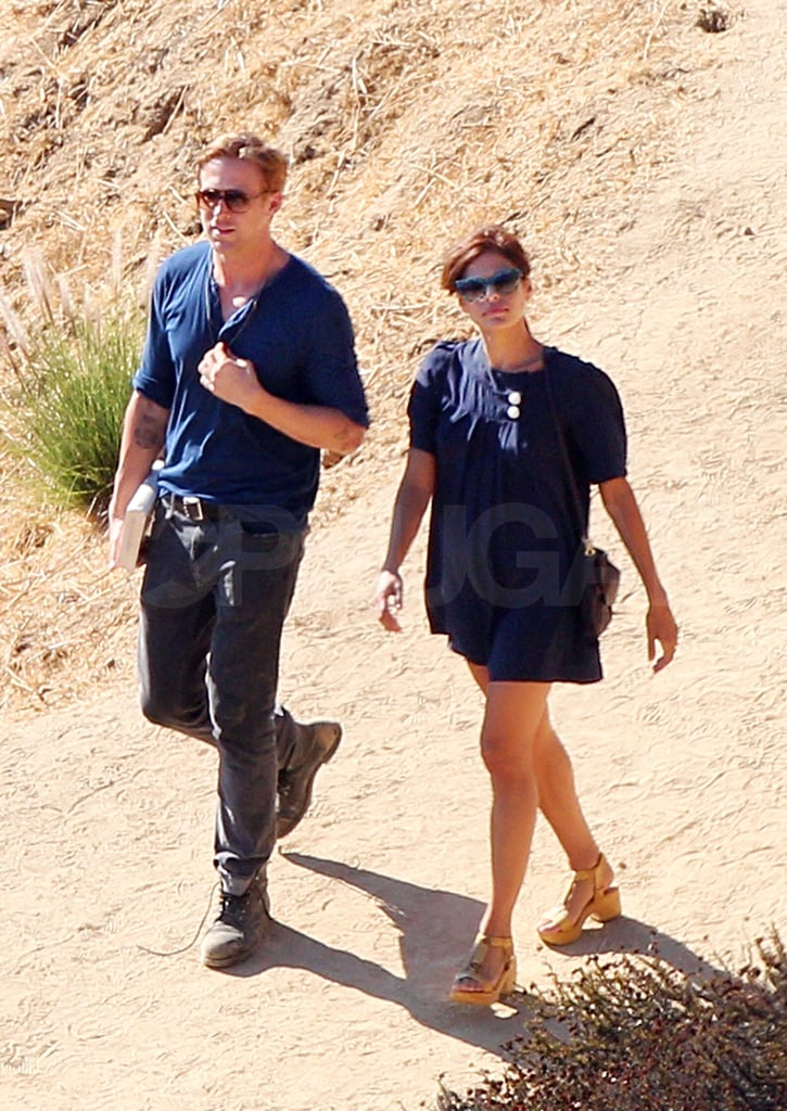 """Hot couple Ryan Gosling and Eva Mendes were together in LA on Sunday to take a hike up to the Griffith Park Observatory. Eva's out on the West Coast paying Ryan a visit while he works on Gangster Squad. He and Eva grew close over the Summer while they shot The Place Beyond the Pines; though, production on that film has since wrapped. Ryan and Eva's Disneyland date was the first time fans were able to see them showing PDA. In fact, Ryan, who was a Mouseketeer as a child, recently spoke about his experience with Disney in an interview on Conan. There was no addressing the hangout with Eva, but Ryan joked about the cats at Disney. He said, """"They live on the outskirts of the park, and at night, under the cover of darkness, these cats descend into the park and they eat all the mice. . . . The thing that's so messed up about it is that the whole empire of Disney is built on the back of one mouse. If you're a mouse and you go into Disneyland, you are not leaving alive."""" There wasn't any overt showing of love, or even kissing, during their latest outing together, but Eva may have needed a steadying hand from Ryan as she trekked down the hill in a pair of clog sandals."""