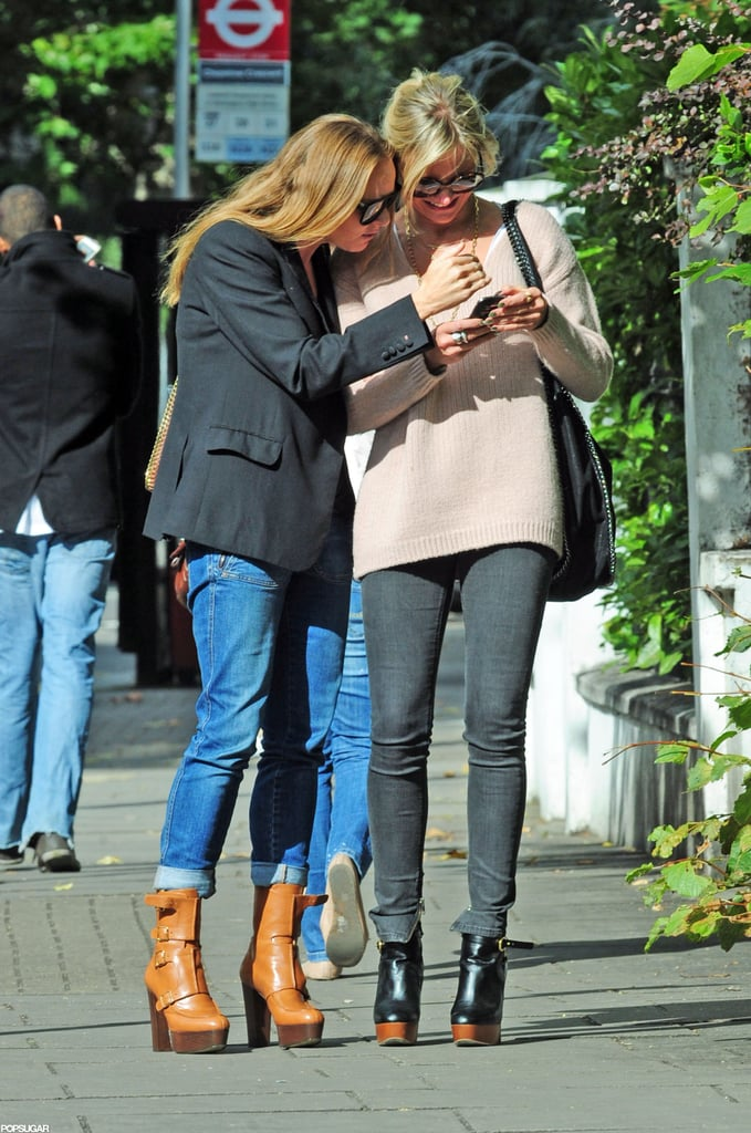 Cameron Diaz and Stella McCartney checked their phone.