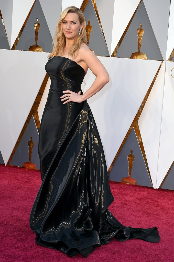 "For Sunday's Academy Awards in Los Angeles, Kate Winslet went back to basics. She selected a black, slightly shimmering strapless gown from Ralph Lauren to attend the show. The piece was custom-made for Kate and made of silk lamé. She kept her accessories light too, wearing a Nirav Modi bracelet, ring, and earrings. The total effect was something Ralph's team dubbed ""stunning"" in a post on Twitter. But Ralph wasn't the only main man during Kate's night, as she also walked the red carpet with Leonardo DiCaprio."