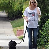 A then-pregnant January Jones walked her pooch, Max, in LA in July 2011.