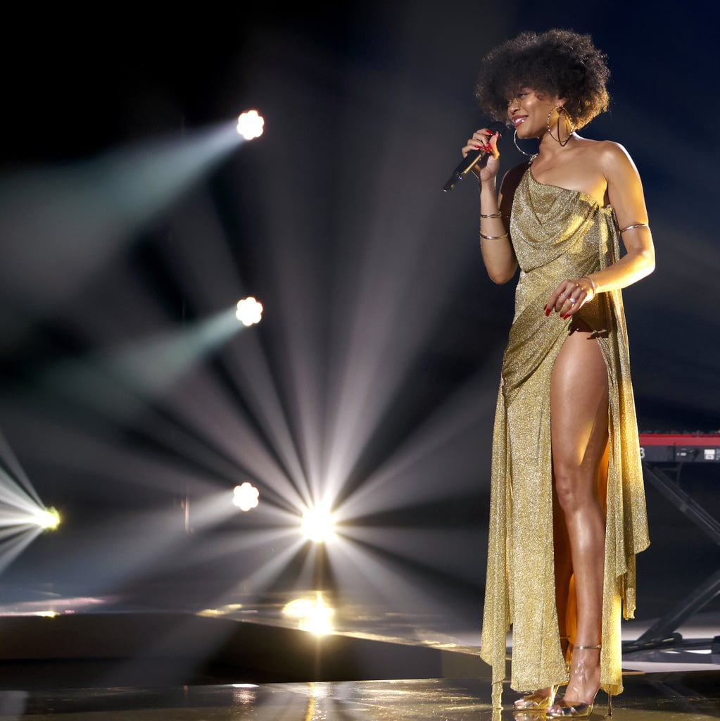 Andra Day Wears Gold Dress With Leg Slit to Essence Awards