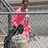 Jennifer Lopez landed in La wearing sunglasses and a bright pink ensemble.