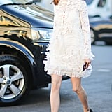 Olivia Palermo smartly grounded her lacy, frilly number with black leather loafers.