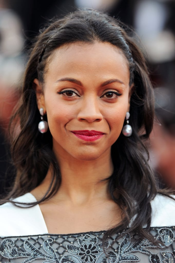For the Blood Ties premiere, Zoe Saldana stuck to her go-to makeup palette of red lipstick paired with winged liner. Makeup artist Vera Steimberg was inspired by Audrey Hepburn when creating her look. To achieve the classic style, Steimberg used Laura Mercier Crème Eye Liner in Noir ($22) to enhance Zoe's eyes, along with the brand's Stickgloss Lip Colour in Cranberry ($22) on her lips.