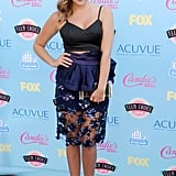 Ashley Benson took to the turquoise carpet in a Bec & Bridge crop top that she accented with bright pumps, an Edie Parker clutch, and Kara Ackerman jewels.