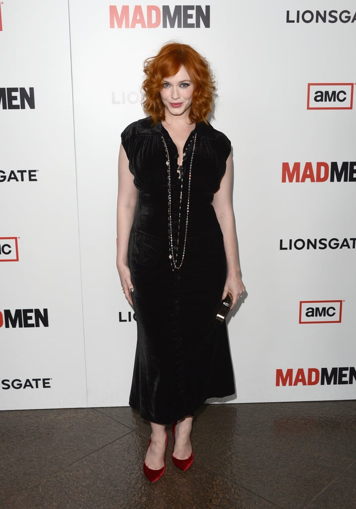 Christina Hendricks showed off her curves in a black velvet L'Wren Scott dress, which she accessorized with a long necklace and coordinating velvet red pumps.