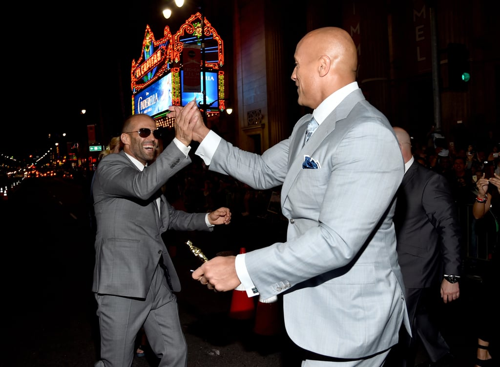 Dwayne Johnson and Jason Statham high-fived each other at the Hollywood premiere of Furious 7 in April 2015.