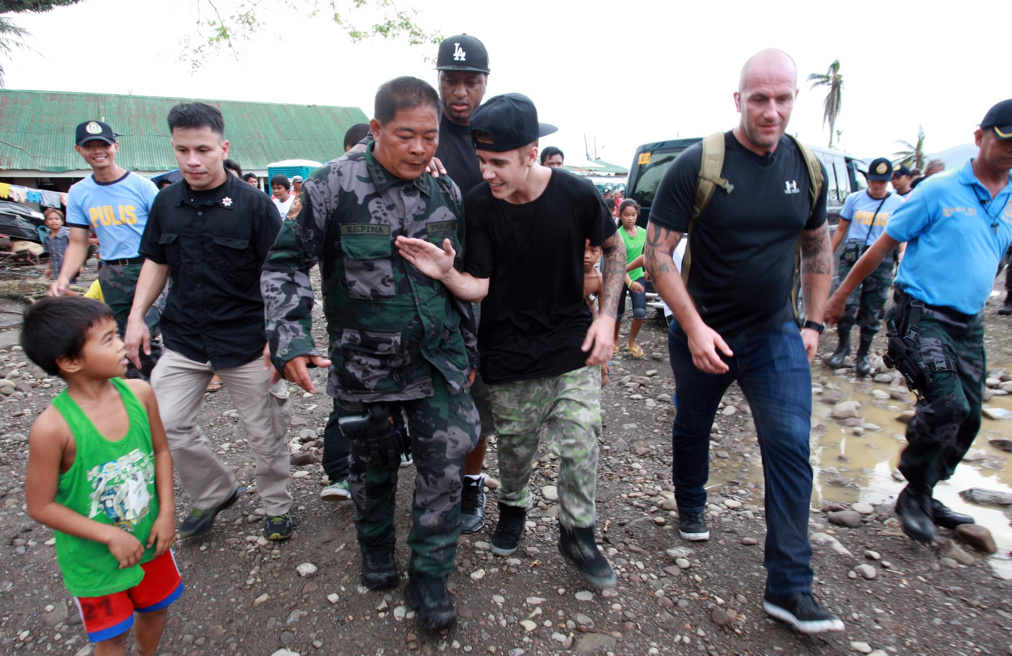 "Source: Getty/Jeoffrey Maitem  Dec. 10, 2013 The pop star got some much-needed good press when he visited an area of the Philippines that was left devastated by the recent typhoon. He spent the day meeting with children and playing basketball with a group of teenagers.  Dec. 24, 2013 Justin sent his fans into chaos when he announced via Twitter that he was ""officially retiring."" However, he quickly backtracked and claimed it was just a joke. A source close to the singer claimed that he did it to show ""how quickly news spreads without anyone vetting if it's true or not."" Dec. 25, 2013 On Christmas Day, Justin released Believe, the movie followup to his wildly successful first documentary, Never Say Never. However, the film was considered a bomb for the pop star, only earning $3.1 million in its opening week. For the sake of comparison, Never Say Never earned $29.5 million its opening weekend. Jan. 10, 2014 Justin allegedly egged a neighbor's home inside his ritzy Calabasas neighborhood. The neighbor released a video of the incident, which contains the voice of a young man who sounds like Justin cursing out his neighbor while throwing eggs. The neighbor called the cops on Justin and reported $20,000 in damage. Jan. 14, 2014 The star's Calabasas home was raided as part of a police investigation related to his alleged egging incident. Justin's friend Lil Za was arrested in Bieber's home for felony drug possession as part of the raid. He was released a few hours later but was arrested once again after he broke a phone inside the jail. Jan. 21, 2014 Justin reportedly spent $75,000 at a strip club in Miami while celebrating the birthday of Love & Hip Hop Atlanta star Lil Scrappy."