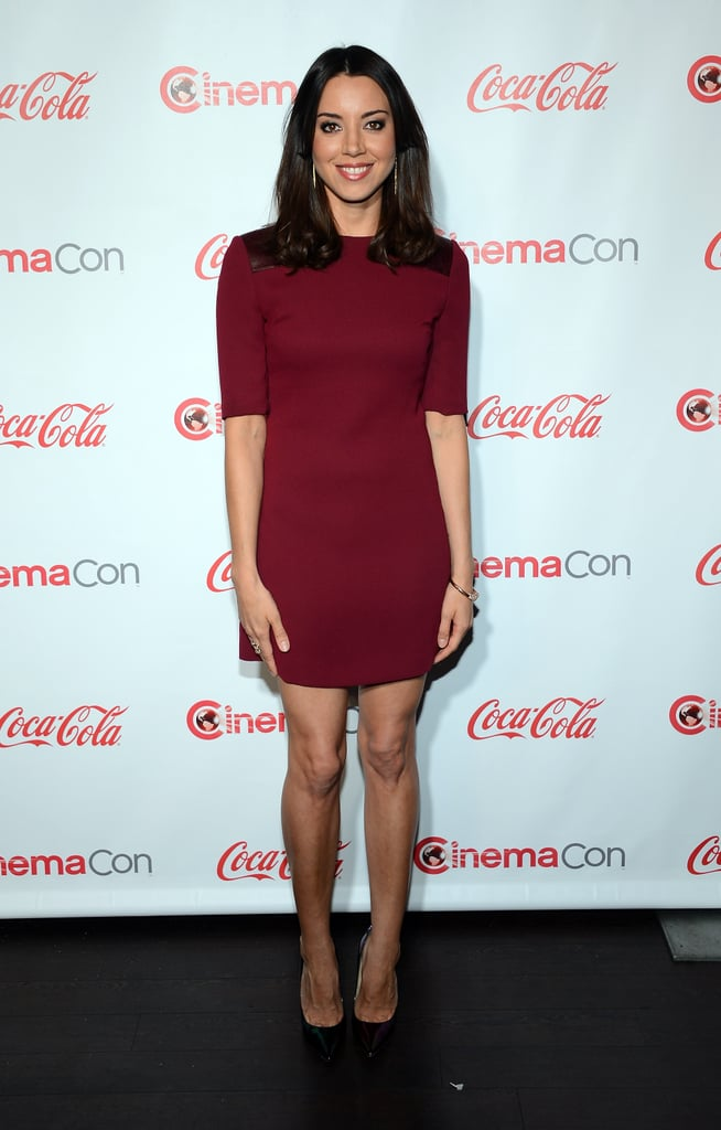 Aubrey Plaza put a feminine foot forward at CinemaCon in a dark red minidress, classic black Jimmy Choo pumps, and an EFFY Jewelry bangle.