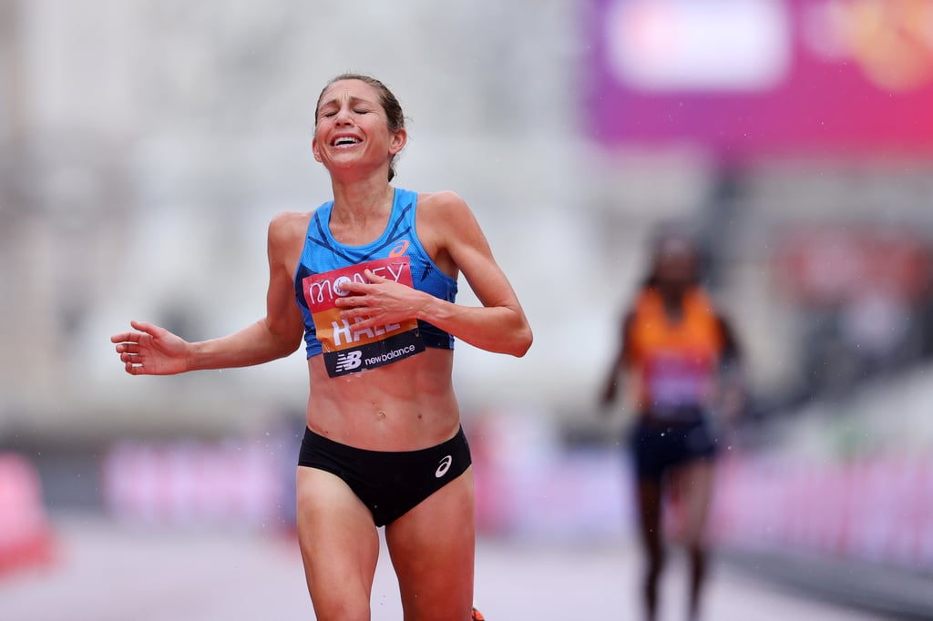 """On a rainy Oct. 4, distance runner Sara Hall overtook 2019 world championship marathon title holder Ruth Chepngetich to place second at the 2020 London Marathon, where the course was reduced to elite runners due to COVID-19. Hall was unable to outrun Kenyan Brigid Kosgei, who defended her title from last year, but the American finished in 2:22:01, which is a PR for her and the sixth fastest marathon time in US history ran by a woman on a record-eligible course. This marked the first time that an American medalled at the London Marathon since Deena Kastor won the race in 2006 and also set the US record. Hall full-on sprinted past Chepngetich in the final 150 meters, and it was an exciting last-minute push if we ever did see one. """"I was fighting that whole way just catching people, and seeing the world champion there in the last lap, that definitely motivated me to give it my all,"""" she told FloTrack. She admitted that the conditions were hard to run in and also said that it was difficult having no fans there watching. However, she explained, """"when I started to feel sorry for myself, I would just say how blessed I was to have a race during this time."""" When it came to her Tokyo Olympic bid earlier this year, Hall did not make the cut, but she called her performance at the London Marathon a redemption. """"Keep chasing the things in your heart, even in the midst of disappointment and uncertainty,"""" she tweeted after the fact. """"It's worth it."""" Ahead, check out the inspiring footage of Hall striding into second place, and see more awesome imagery from her finish at the 2020 London Marathon. She said, at age 37, that she is enjoying her career the most she's ever had — and we're sending her the biggest congratulations!"""