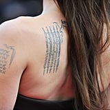 Buddhist Pali Incantation on Her Left Shoulder Blade