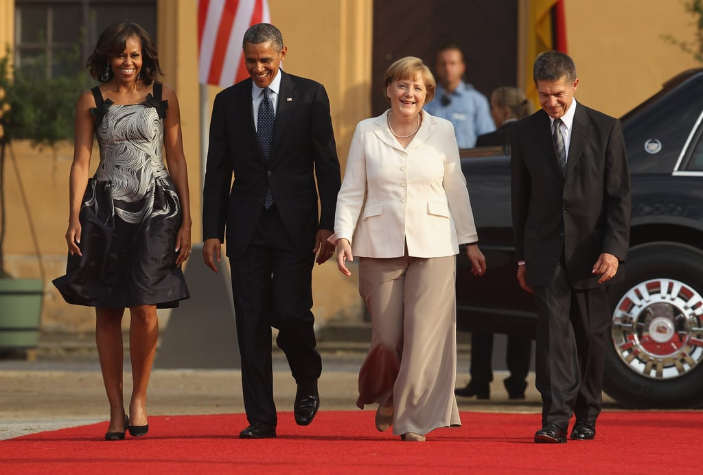 Barack and Michelle Obama attended a dinner in the president's honor with German Chancellor Angela Merkel and her husband, Joachim Sauer, in Berlin, Germany, in June 2013.
