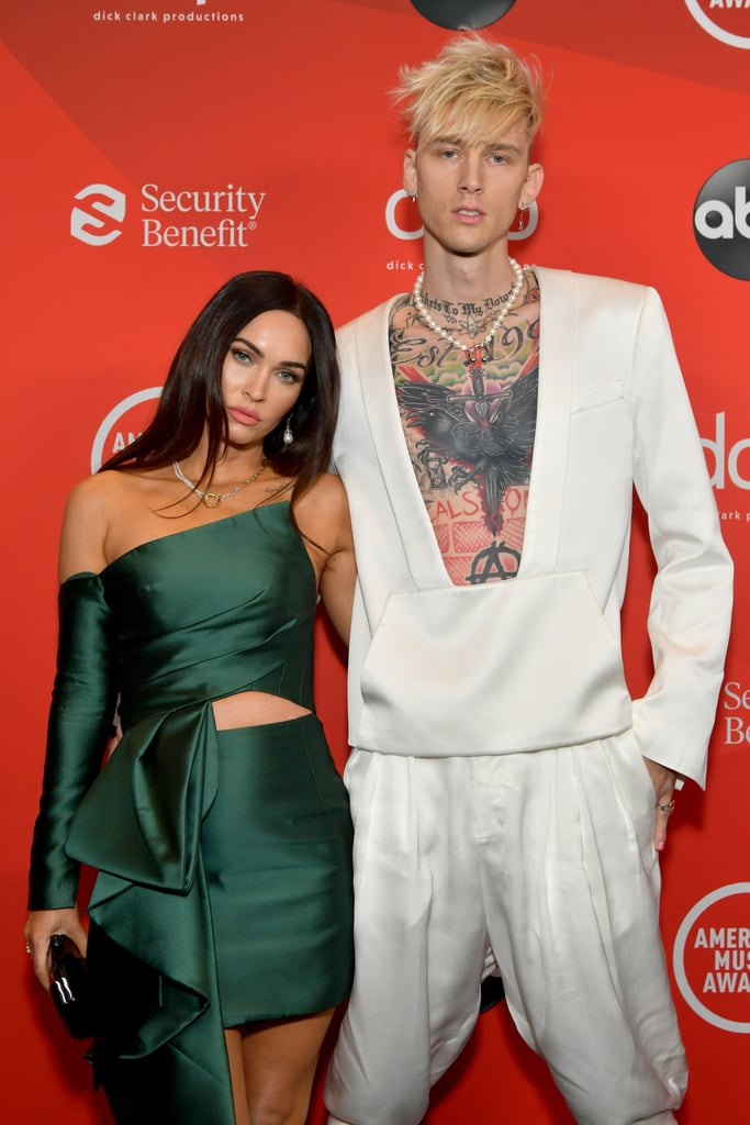 "It was date night for Megan Fox and Machine Gun Kelly at the American Music Awards. On Sunday, the couple celebrated a special relationship milestone at the LA ceremony: their first public appearance together. Megan heated things up in an emerald ensemble, while MGK opted for an all-white look ahead of his performance.  Rumors of a romance between Megan and MGK first began swirling in May, which is around the same time that Brian Austin Green announced his separation from Megan after 10 years of marriage. However, it wasn't until a month later that the 30-year-old rapper seemingly confirmed their relationship on social media when he tweeted, ""'I'm calling you girlfriend, what the f*ck.' Life imitated art on that one,"" referencing his song ""Bloody Valentine."" Most recently, the 34-year-old actress and mom of three opened up about their relationship to Nylon, referring to it as a ""once in a lifetime thing"" and saying they have a connection of ""mythic proportions."" See more of their glamorous date night ahead.      Related:                                                                                                           Who Has Machine Gun Kelly Dated? Read Up on the Rapper's Quiet Romantic History"