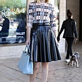 Ladylike leather was made all the more sweet via a pale blue Prada tote.
