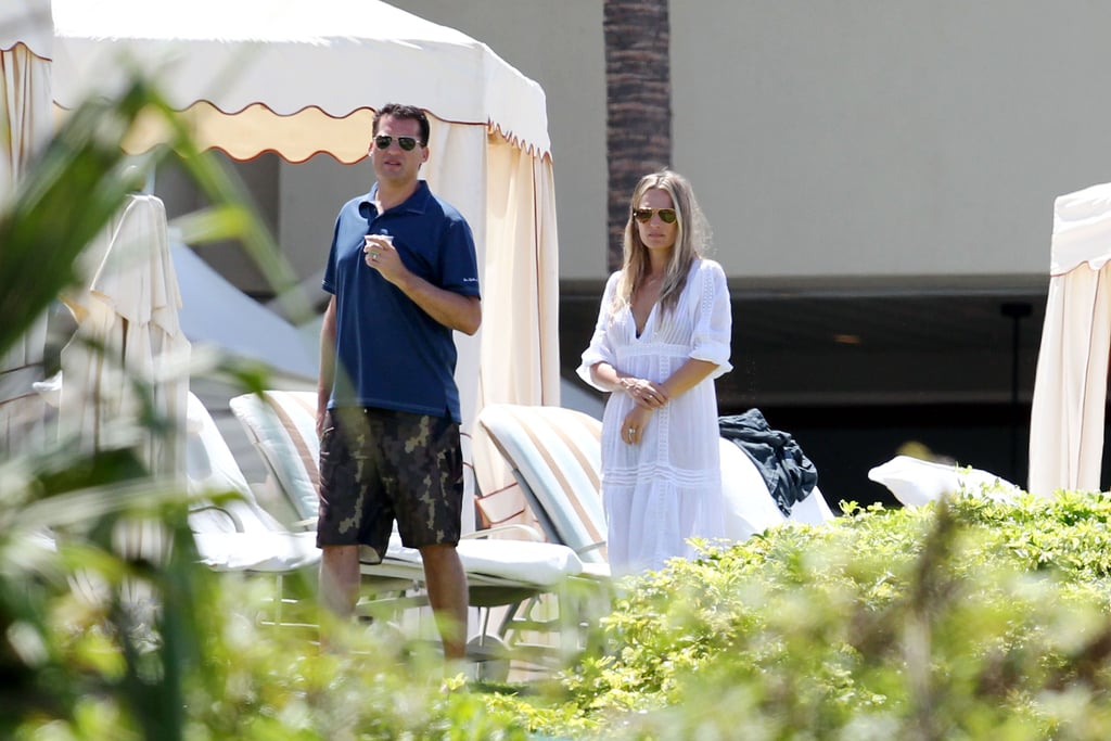 Molly Sims wears a white cover-up over her bikini.