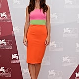 Sandra Bullock attended a photo call for Gravity at the Venice Film Festival looking bright in a neon colour-block Alex Perry shift dress with nude ankle-strap sandals.