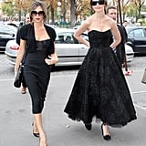 Victoria in Paris with Katie Holmes in 2006, wearing a bustier-style dress.
