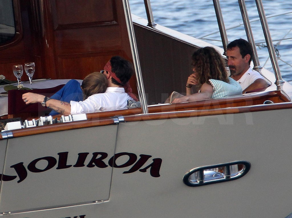 Jack Depp snuggled up to Johnny during their day cruise.