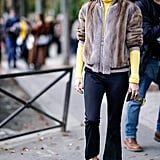 A furry bomber was the finishing touch on this cozy look at Paris Fashion Week.