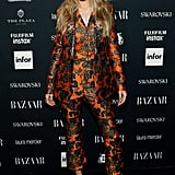 During Fashion Week, Gigi debuted a series of good outfits, including this Dolce & Gabbana embroidered pantsuit in Sept. 2017. She wore a pair of Christian Louboutin pumps.